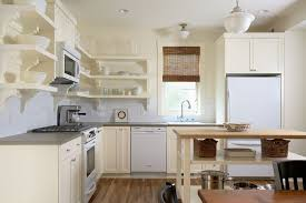 Cream Colored Kitchen Cabinets With White Appliances To Coordinate White And Cream In The Kitchen