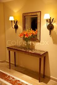 Mirror And Table For Foyer Foyer Table At Home Entrance With Flowers And Mirror Stock Photo