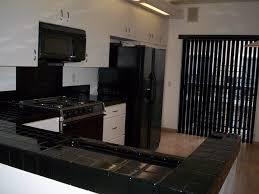 black countertops kitchen ideas granite reviews white cabinets bar