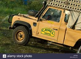land rover defender 90 yellow camel trophy land rover defender stock photo royalty free image