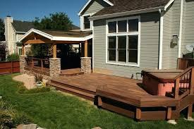 define porch stone columns define porch transition to wood deck