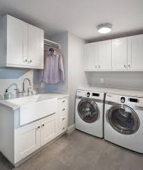 laundry room with large sink and white cabinets affordable and