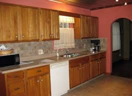 kitchen grey wall paint and brown wooden oak cabinet on laminate