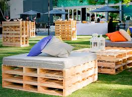 rustic pallet seats with padded and scattered cushions are