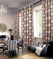 majestic eyelet orange curtains hang on black rods also cool black