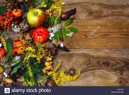 happy thanksgiving decor with pumpkin apples and rowan berries on