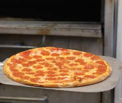 hand tossed thin crust pepperoni pizza fresh from the oven at
