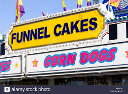 funnel cakes and corn dog signs at carnival in usa stock photo