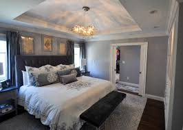 master bedroom with stepped soffit ceiling with solid crown