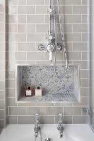 tile bathroom walls ideas gray subway tiles frame a blue mosaic tiled niche located below a