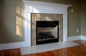 interior black iron fireplace frame with brown marble surround and