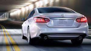 nissan white car 2019 nissan altima rear view white color car in tunnel uhd