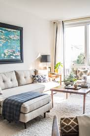 living rooms with properly hung art apartment therapy