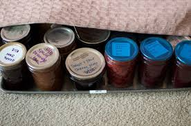 jar storage sheet pans and the space under the couch food in jars