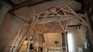 geometric wood sculpture parisian micro apartment optimized through a wooden sculpture