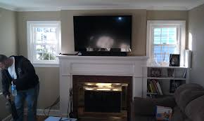 mounting tv over fireplace mantel with mounted above decor on