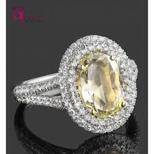 fancy yellow diamond engagement rings 1 95 tcw oval cut fancy yellow diamond halo engagement