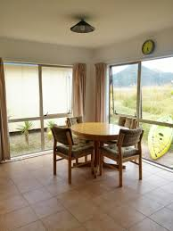 top bach coromandel nz with excellent facilities right beside beach