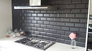 black subway tile kitchen black granite with subway tile thick grout line in