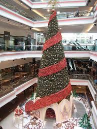 huge christmas tree at the festival walk shopping mall at kowloon