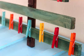 dyed wooden clothespins and a christmas card display