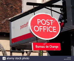 bureau change post office sign premises with bureau de change currency stock