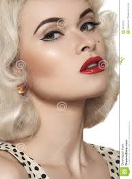 hair and makeup vintage retro 50s old fashioned pin up model red lips make up blond curly