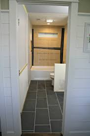 how to tile a bathroom floor it u0027s done from thrifty decor