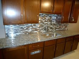 Brown Backsplash Ideas Design Photos by Kitchen Metal And White Glass Random Schluter Strip Backsplash