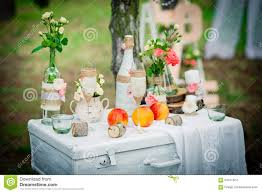 wedding decor with bottles glasses roses vases and peaches on