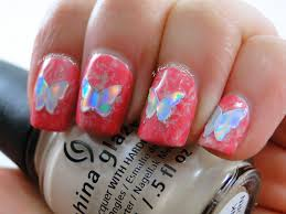 i feel polished plastic wrap nail art with holo butterflies