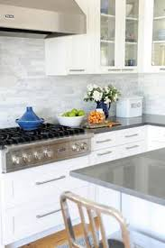 grey painted cabinets with white marble pillowed subway tile