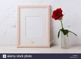 wooden frame mockup with red rose in glass vase empty frame mock