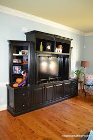 Computer Armoire With Pocket Doors by Painted Black Entertainment Center With Open Shelving And Pocket