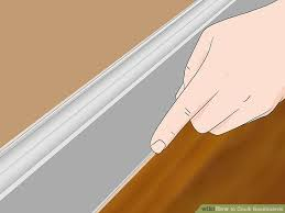 Hardwood Floor Molding How To Caulk Baseboards With Pictures Wikihow