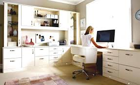 home office with a grey desk bookcases and a swivel chair with
