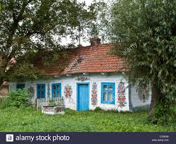 an old farm house with decorated walls in the polish village of