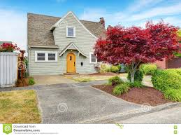 classic american house exterior with nice landscape desing stock