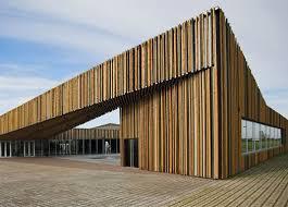rivestimento listelli legno s禝meru community center legno multicolor per interni e facciata