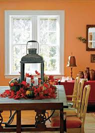 dining room table centerpieces candle lantern and leaves