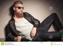 cool guy resting on studio floor stock photo image 44272460