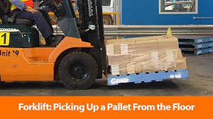 forklift picking up a pallet from the floor safety training