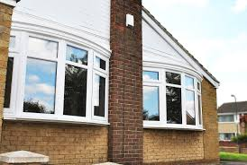a fantastic rennovation full house of high quality rehau windows close up of our two beautiful bow windows in high quality white rehau upvc profile with top and bottom openings in each side and beautiful bow canopy