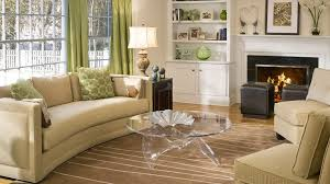 coffee table patterned grey area rug living room with beige sofa