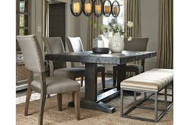 Strumfeld Dining Room Table Ashley Furniture HomeStore - Ashley furniture dining table black