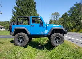 lowered 4 door jeep wrangler improving your wrangler s handling suspension components explained
