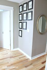 hickory hardwood flooring and staircase makeover gallery wall