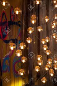 pictures with lights behind them abstract of hanging lights with various colors behind them stock