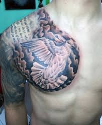 flying dove in clouds with quote on half chest for