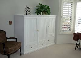 White Tv Cabinet With Doors White Entertainment Center With Pocket Doors Custom Freestanding